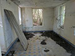 With it's tiled floor still visible, this once held storage shelves